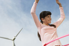 Girl Playing With Hula Hoop Royalty Free Stock Image