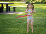 Girl Playing with a Hula Hoop Royalty Free Stock Photos