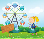 A girl playing with the hula hoop near the empty board Royalty Free Stock Image