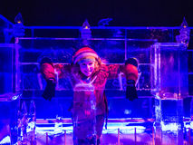 Girl playing in the Ice Palace, Winter Wonderland, London, Christmas week Stock Images