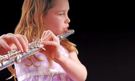 Girl Playing Instrument Royalty Free Stock Photo