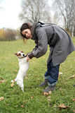 Girl with jack russel terrier Stock Images