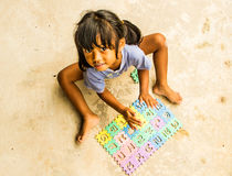 Girl playing jigsaw Royalty Free Stock Photo
