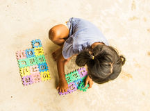 Girl playing jigsaw Stock Photos