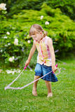 Girl playing with jump rope Royalty Free Stock Photos