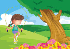 A girl playing jumping rope at the hill. Illustration of a girl playing jumping rope at the hill Stock Images