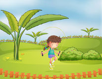 A girl playing jumping rope in the park. Illustration of a girl playing jumping rope in the park Royalty Free Stock Photos