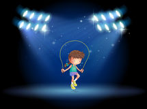 A girl playing jumping rope under the spotlights Royalty Free Stock Photo