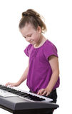 Girl playing keyboard Royalty Free Stock Photography
