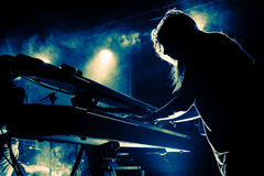 Girl playing keyboards during concert, silhouette Royalty Free Stock Photos