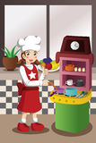 Girl playing with kitchen and cooking toy Stock Photo