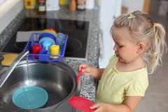 Girl playing in the kitchen Royalty Free Stock Photos