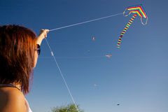 Girl playing with kite Stock Image