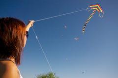 Girl playing with kite Stock Image