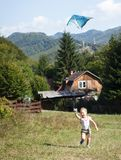 Girl playing with kite royalty free stock photo