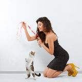 Girl playing with a kitten Royalty Free Stock Photos