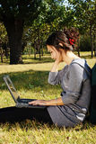 A girl playing laptop Royalty Free Stock Image