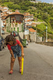 Girl playing with a laser stick in Lastres, Asturias Royalty Free Stock Photos