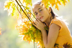 Girl playing with the leaves Royalty Free Stock Photos
