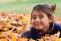 Girl playing in the leaves Royalty Free Stock Photography