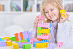 Girl playing lego game Stock Images