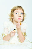 Girl playing with lipstick Royalty Free Stock Photo