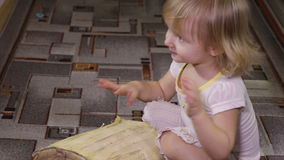 Girl playing with log stock video