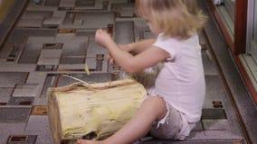 Girl playing with log stock footage