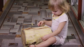Girl playing with log stock video footage