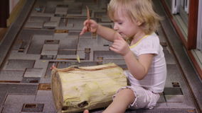 Girl playing with log stock footage