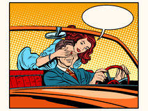 Girl playing with man driver. Pop art retro style. Dangerous driving. Joke. Woman and man Stock Photography