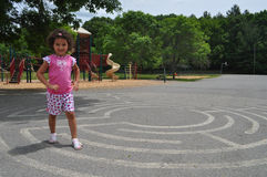 Girl playing on a maze Stock Photo