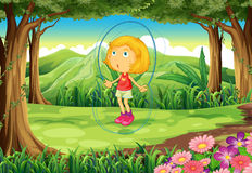 A girl playing in the middle of the forest Royalty Free Stock Images