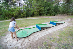 Girl playing miniature golf in the North of Israel Royalty Free Stock Photos