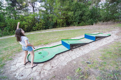Girl playing miniature golf in the North of Israel Stock Photography