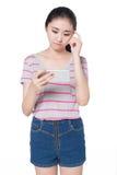 Girl playing mobile games Stock Image