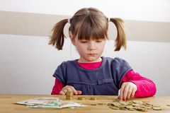 Girl is playing with money Royalty Free Stock Photo