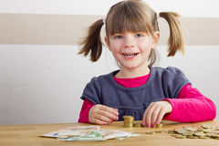 Girl is playing with money Royalty Free Stock Image