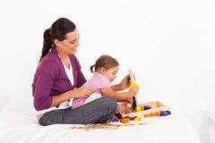 Girl playing with mother Stock Photos