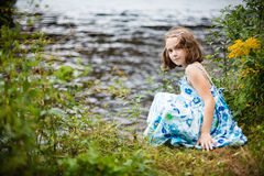 Girl playing near the water Stock Photos