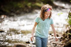 Girl playing near the water Royalty Free Stock Photos