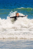 Girl Playing in Ocean Surf Royalty Free Stock Images