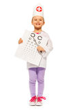 Girl playing oculist with pointer and testing card Stock Photo