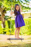 Girl Playing On Swing Set Royalty Free Stock Photography