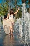 Girl playing at outdoor water fountain Royalty Free Stock Photography