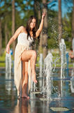 Girl playing at outdoor water fountain Royalty Free Stock Photos