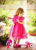 Girl playing outdoors Royalty Free Stock Photography