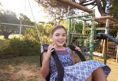 Girl Playing Outdoors At Home On Garden Swing Stock Photography