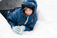 Girl playing outdoors in snow Royalty Free Stock Image