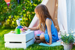 Girl playing outdoors on summer Royalty Free Stock Photos